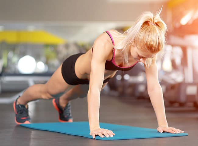 Image of woman doing circle plank