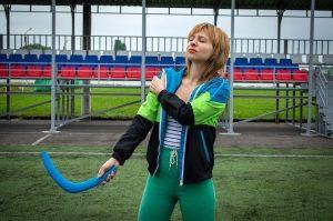 Women feeling shoulder whilst doing sporting activity.